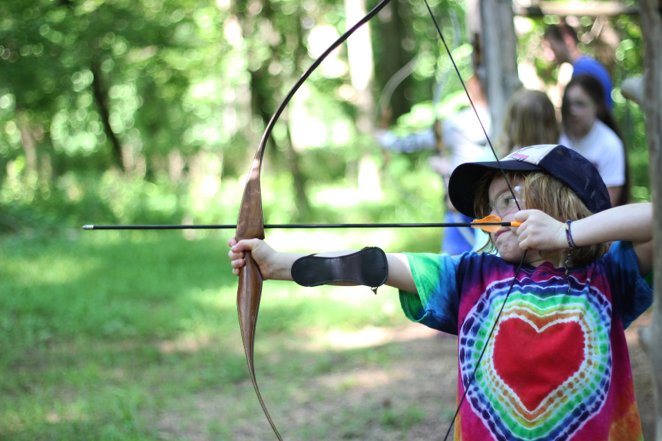 Young girl camper enjoys archery at residential camp in Virginia