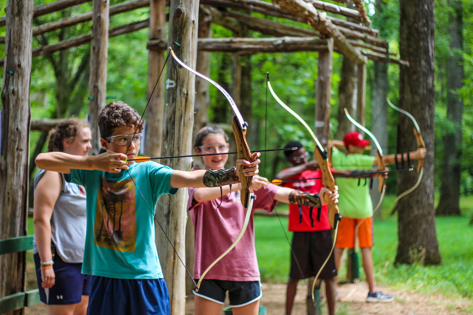 Campers ready their bows and arrows during Archery at Camp Friendship residential camp