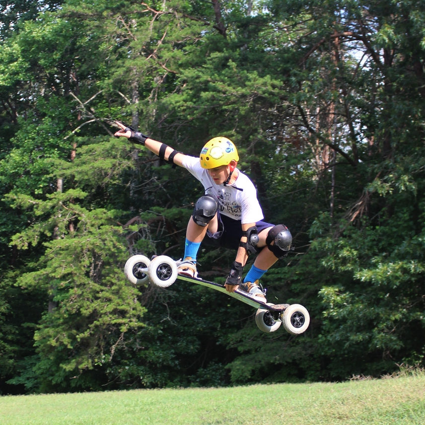 Camper mountain boarding at a sleep-away summer camp