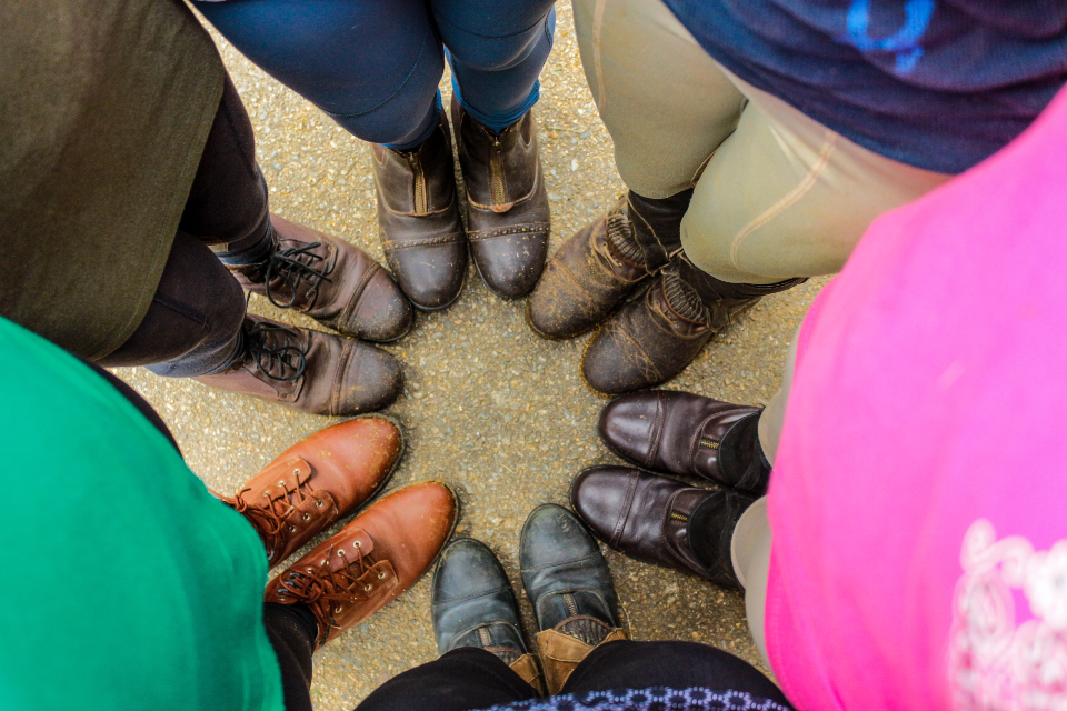 Our horseback riding camp teens show of their riding boots.