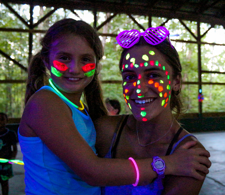 Girl camper and girl counselor having fun at the dance at sleep-away camp