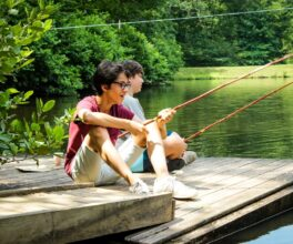 Two senior campers relax and fish off of one of our floating docks.