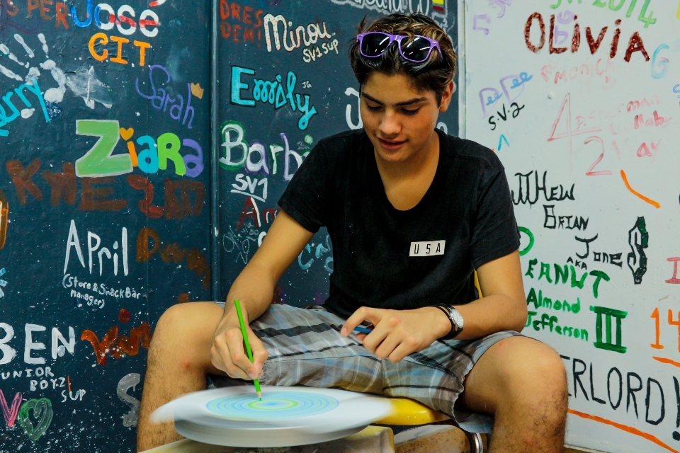 Senior Village boy works on pottery at Camp Friendship sleep-away camp