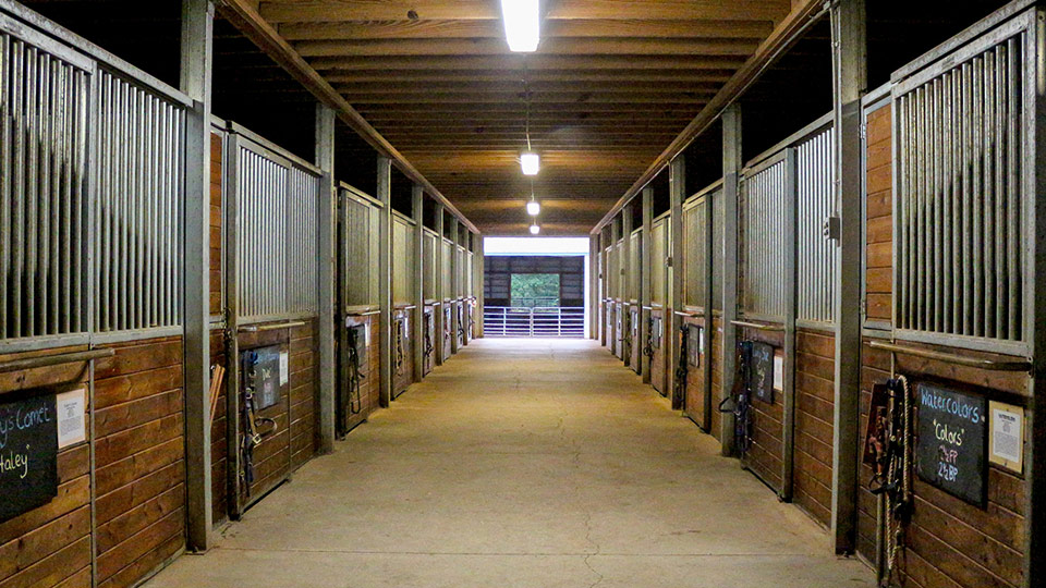 A view of the barn stalls at the Camp Friendship sleep-away horseback riding camp in Virginia