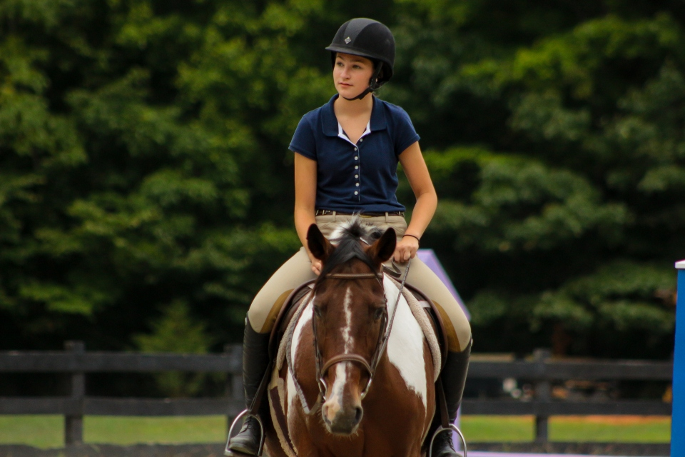 Camper rides her horse in a lesson at the Camp Friendship overnight Equestrian Camp