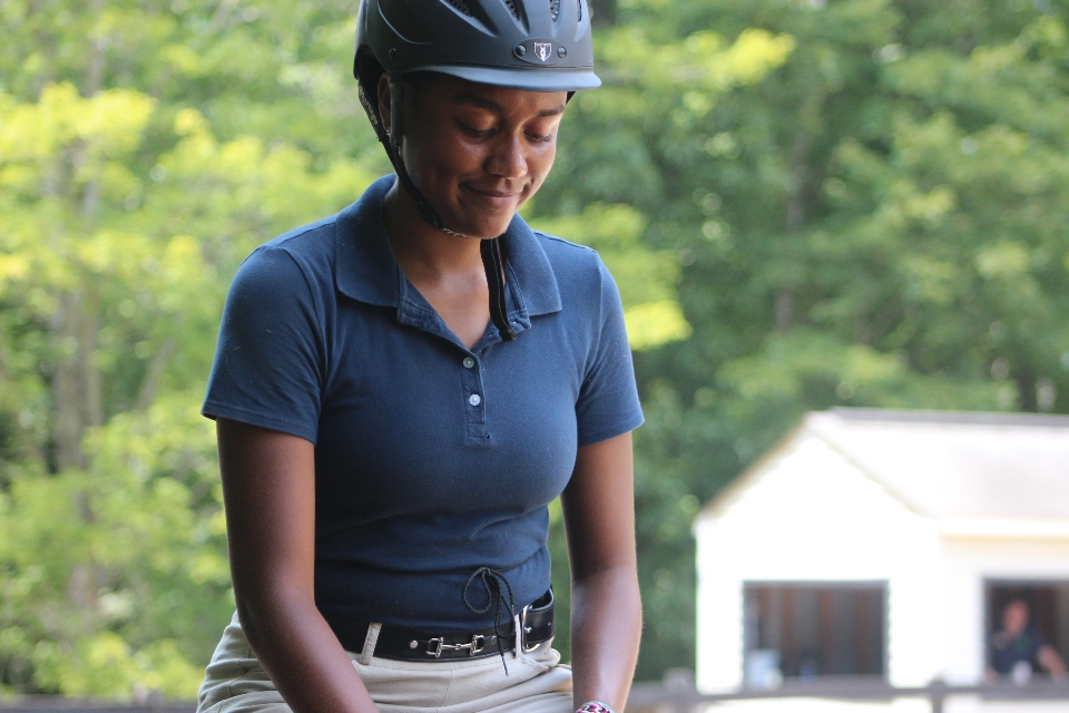 Teen camper during her lesson at the Camp Friendship Equestrian Center overnight camp