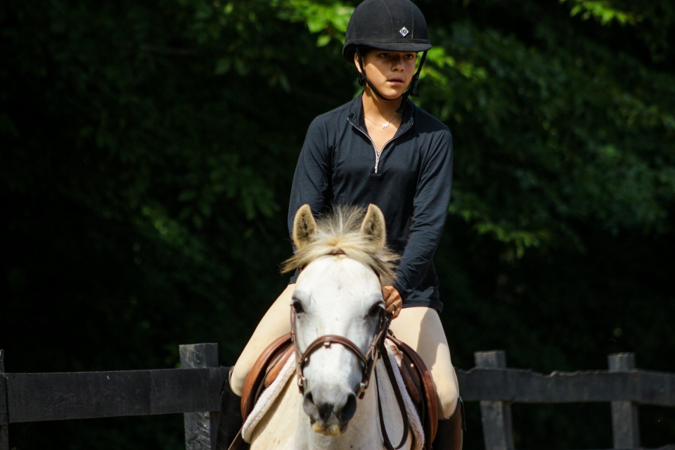 Teen camper trots her horse during a lesson at the Camp Friendship overnight horseback riding camp