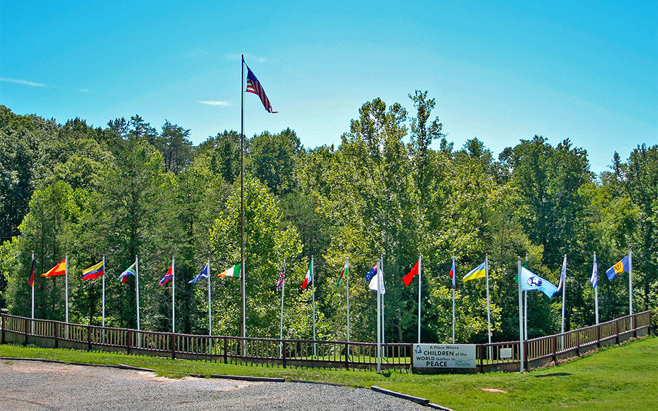 Next to the dining hall we have 19 flag poles to show off exactly which international campers and counselors are present during the week during overnight camp.