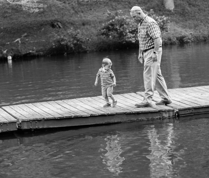 Two family members walk along the floating dock at Friendship Lake in Virginia