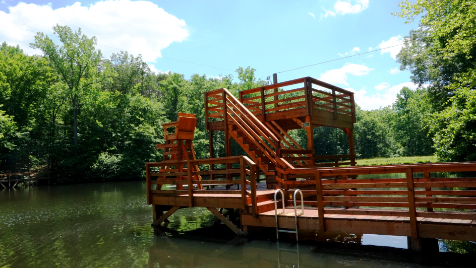 Our dive tower on camp friendship lake.  Including a zip line, diving board, and high dive for our campers to use.