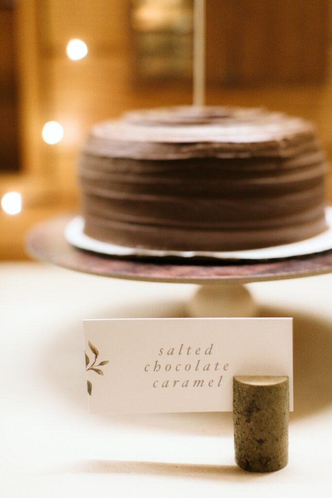A delicious salted chocolate caramel cake sits on a platter for one of our fall retreat programs.
