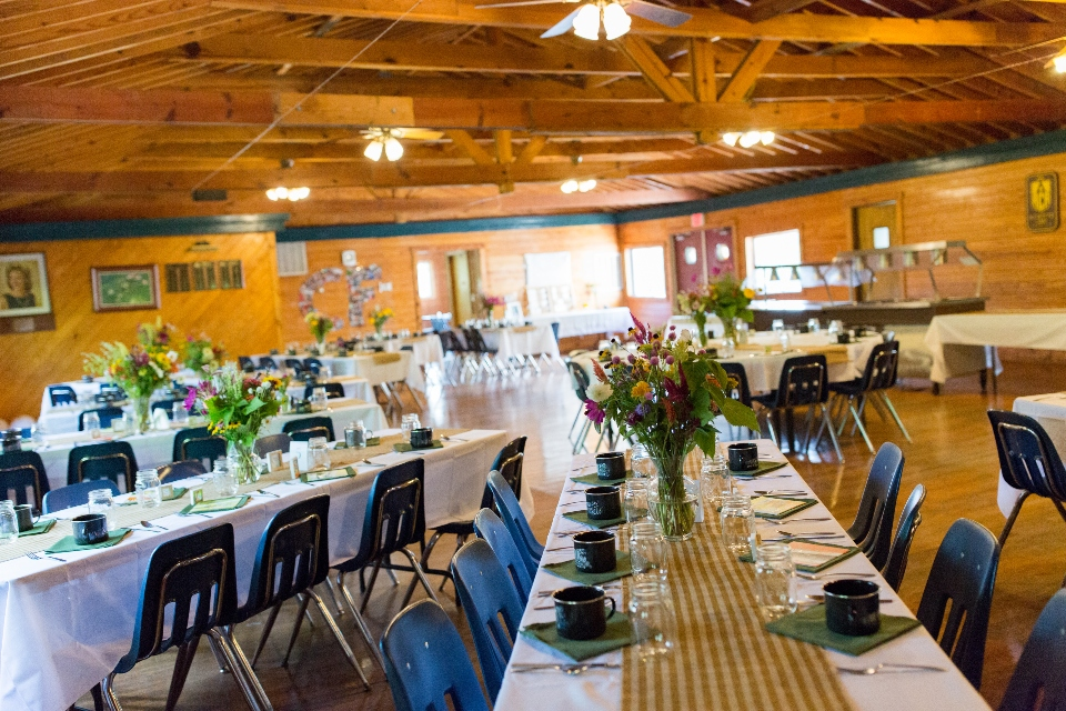 An alternate layout of our dining hall tables, set up for a summer camp wedding.