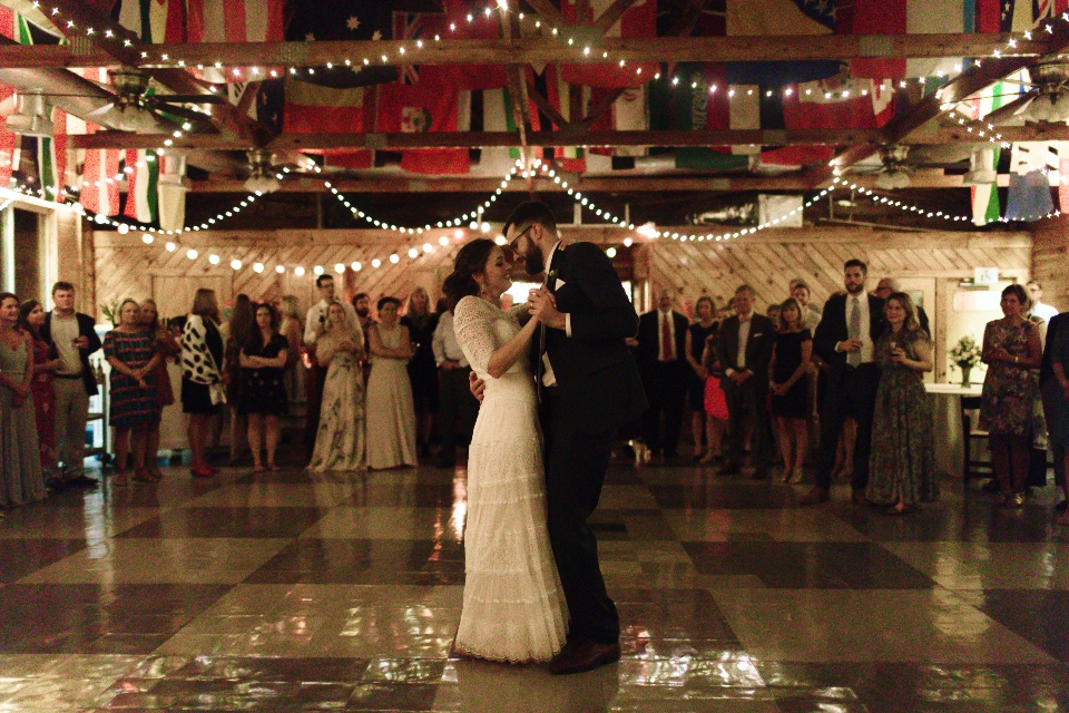 A bride and groom have their first dance in our camp wedding venue dance floor.