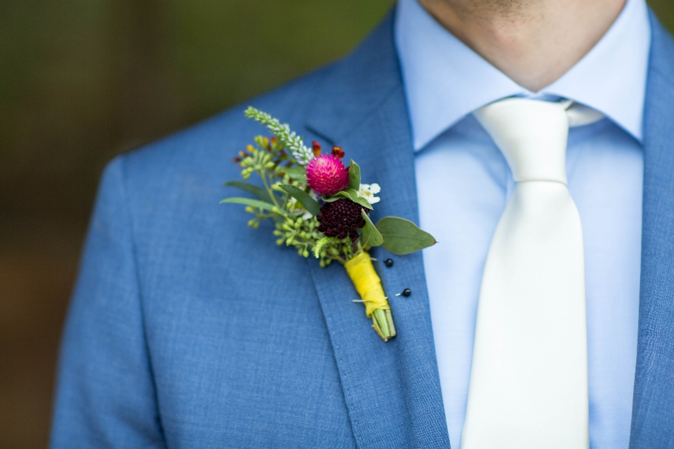 Colorful Boutonniere pinned to groom's jacket
