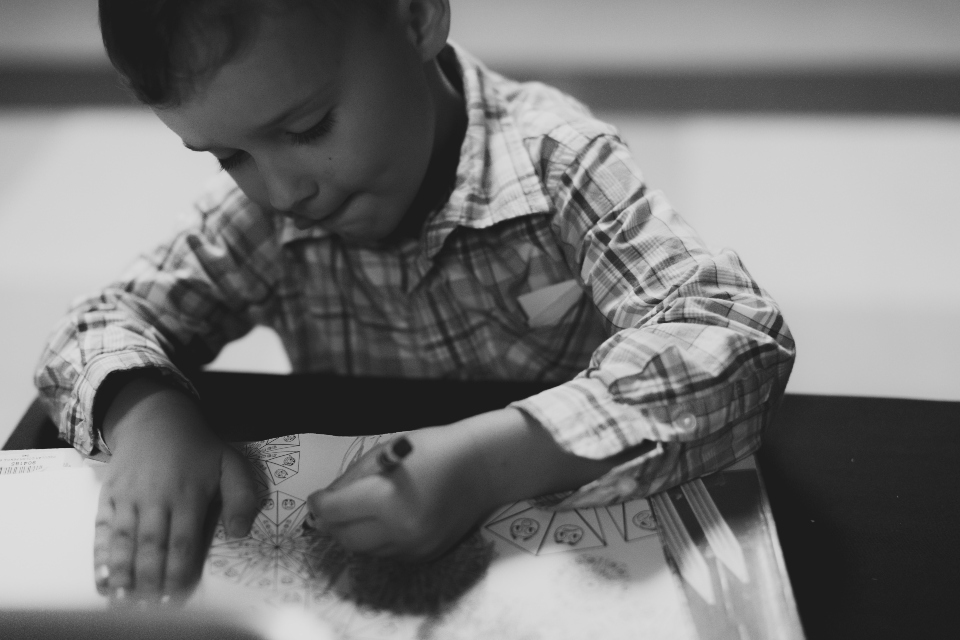 Boy coloring a picture