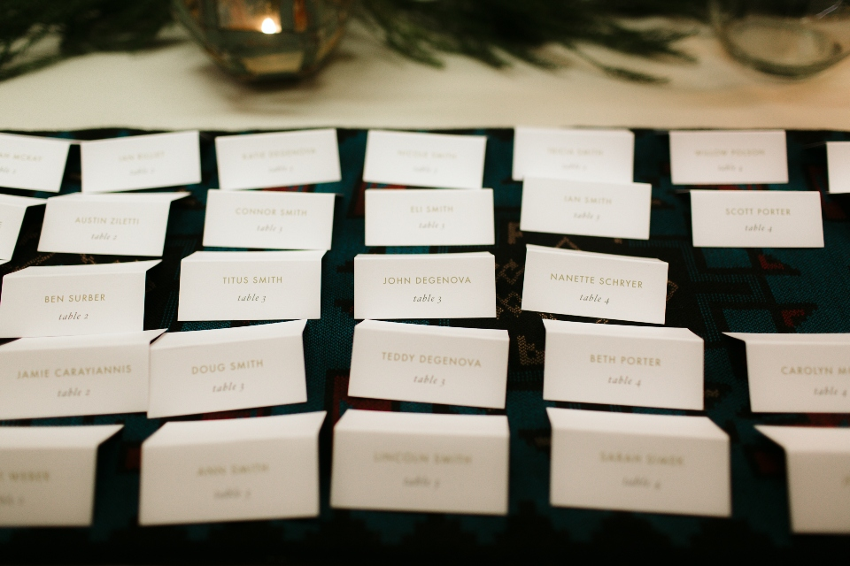 folded seating cards are arranged to help show guests to their tables at our Virginia wedding venue.