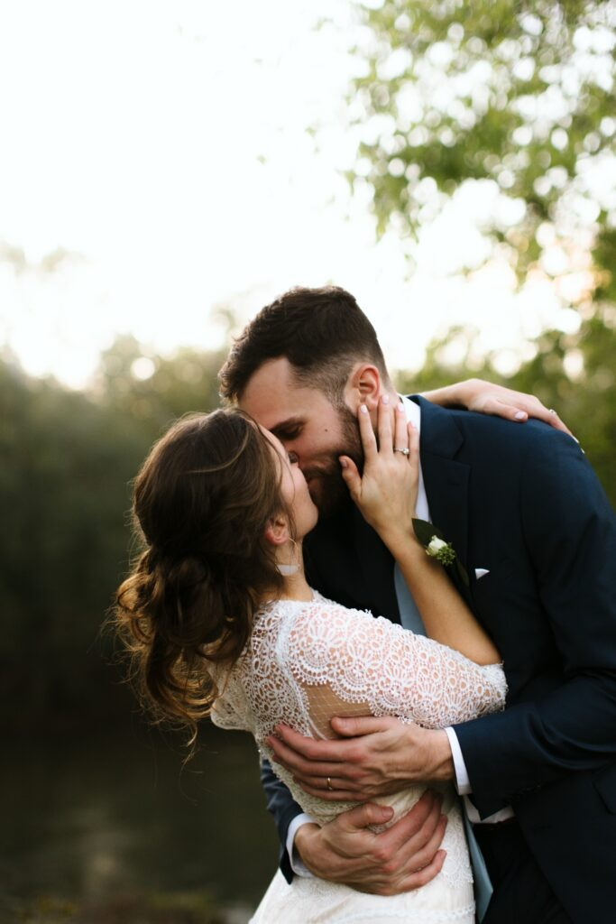 Bride and Groom sharing a kiss at their virginia summer camp wedding