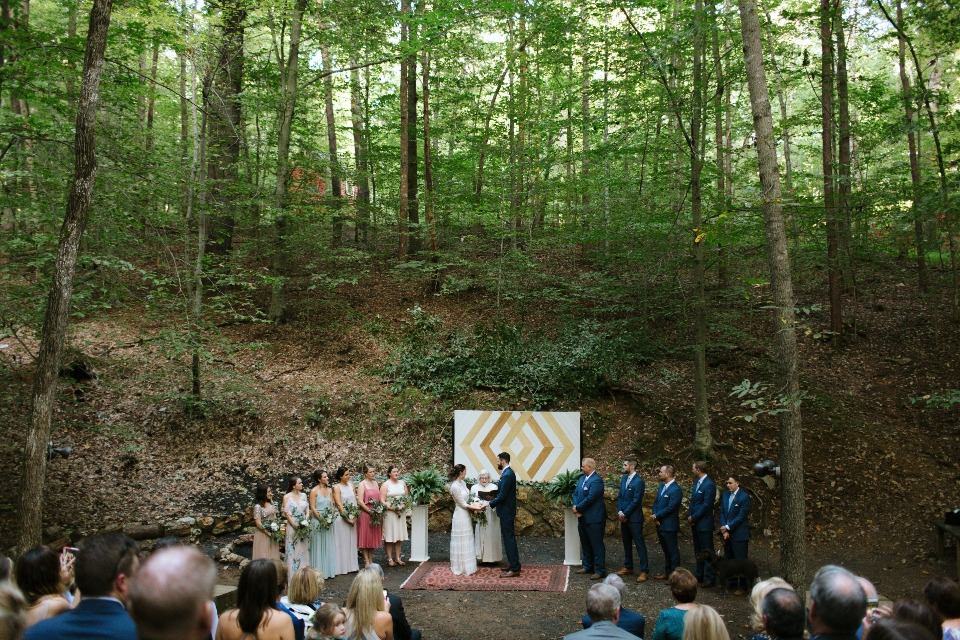 Virginia wedding ceremony in woods with Bride and Groom at center surrounded by Bridesmaids and Groomsmen