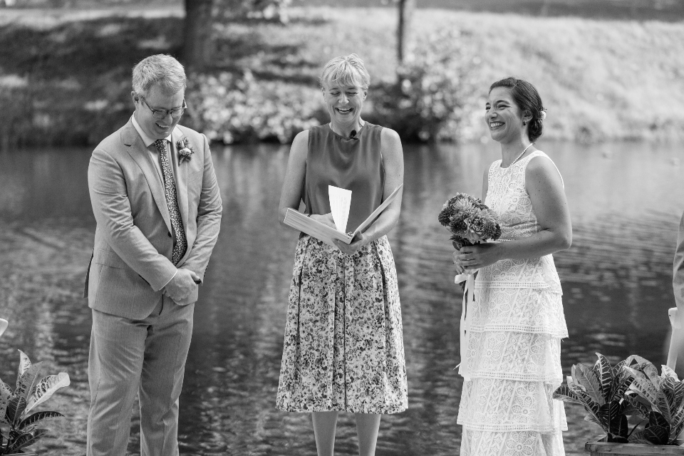Bride and Groom with Officiant next to the water of Friendship Lake