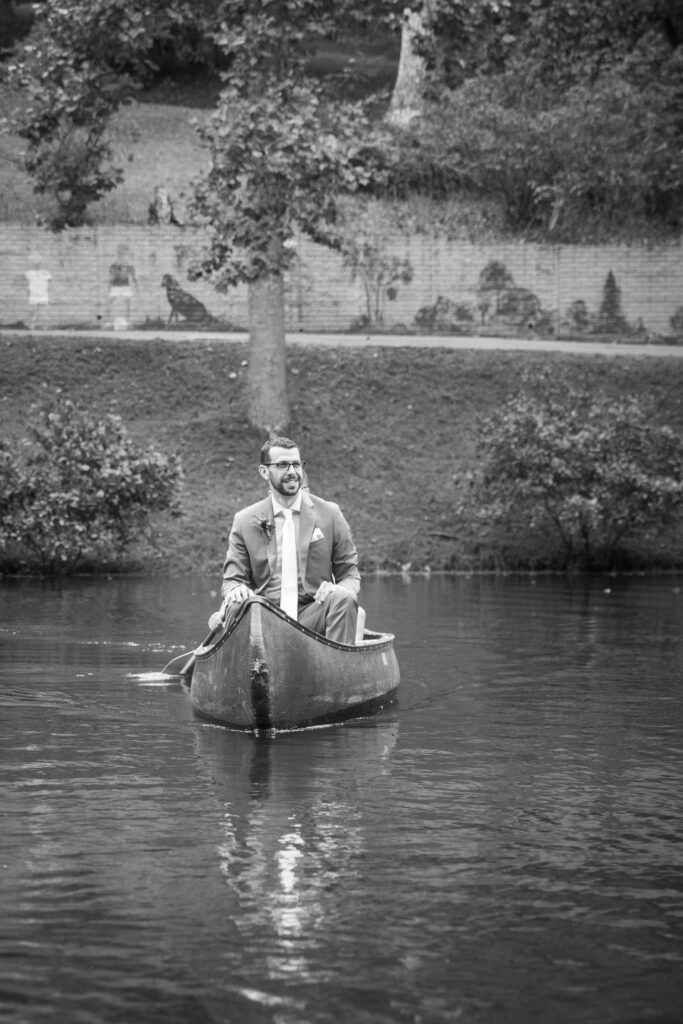 Groom approached the wedding ceremony in a canoe on Friendship lake