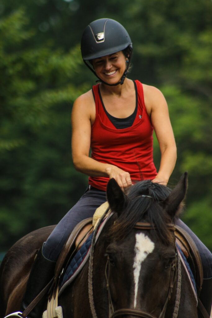 Director Sarah Ackenbom riding a horse to prepare us for our overnight equestrian summer camp.