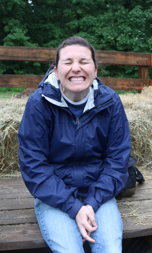 Director Skye Ackenbom smiling on our hay ride at camp with our horses.