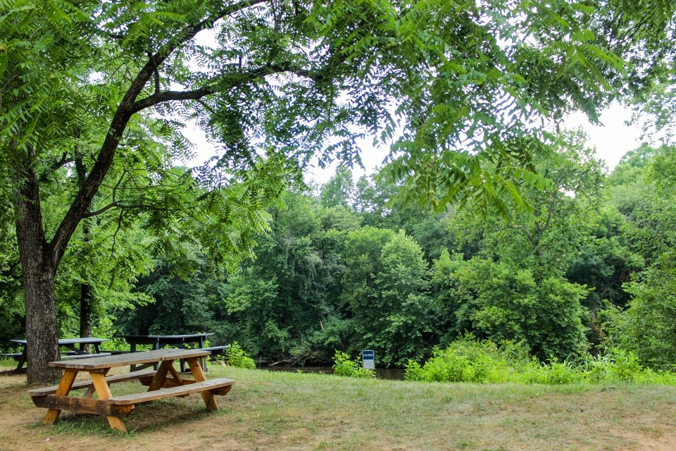 Picnic tables overlooking the Rivanna  River at Camp Friendship overnight camp