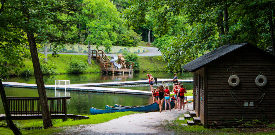 Campers prepare for a canoe lesson on friendship lake.