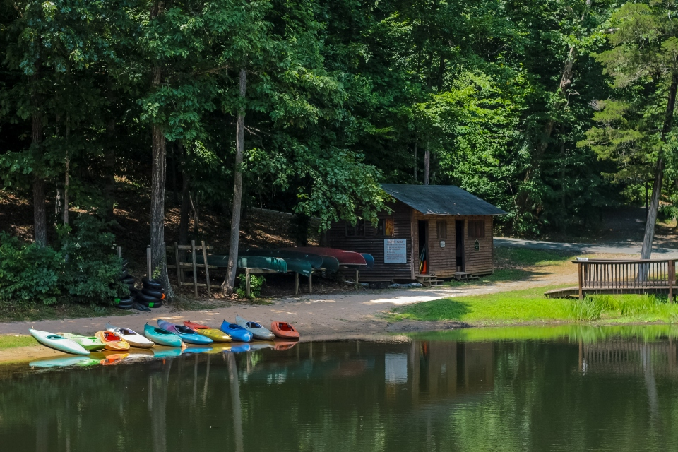 Kayaks on the beach of Camp Friendship Lake