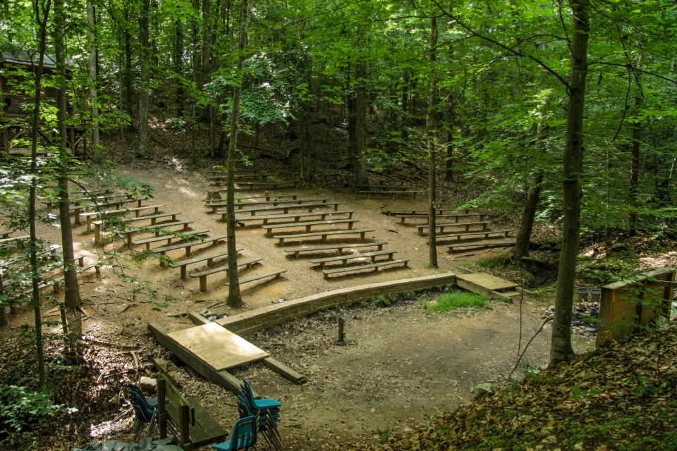 Picture overlooking the campfire stage and seating at outdoor amphitheater at Camp Friendship