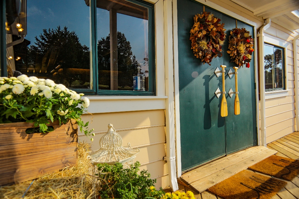 The front doors of our dining hall, decorated with local flowers and canoe paddles.