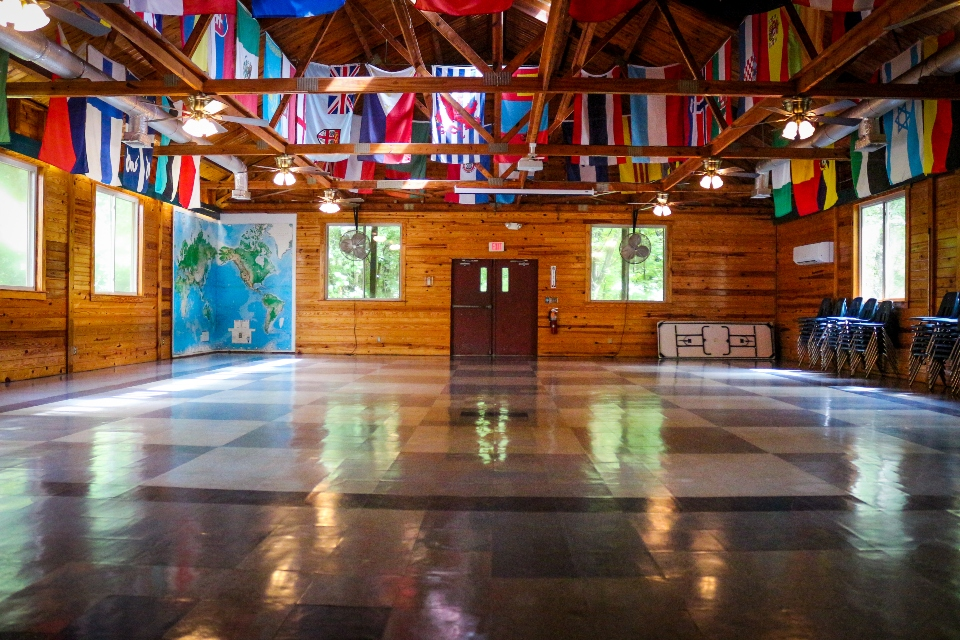 Our flag room in the dining hall sports over 80 different flags from all over the world. Each represents a country that has sent at least one staff member or camper to Camp Friendship in Virginia.