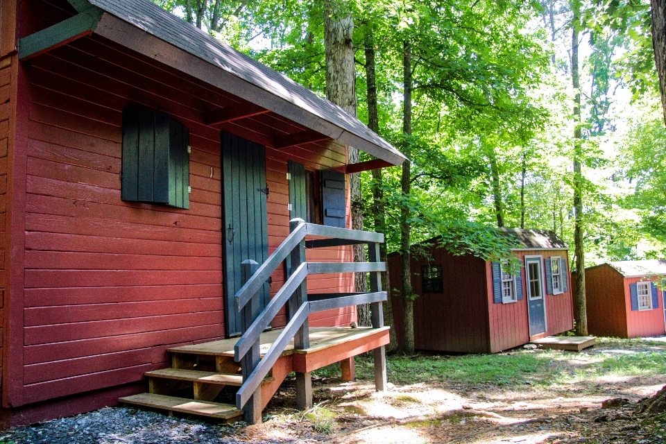 Red cabins with blue doors and trim
