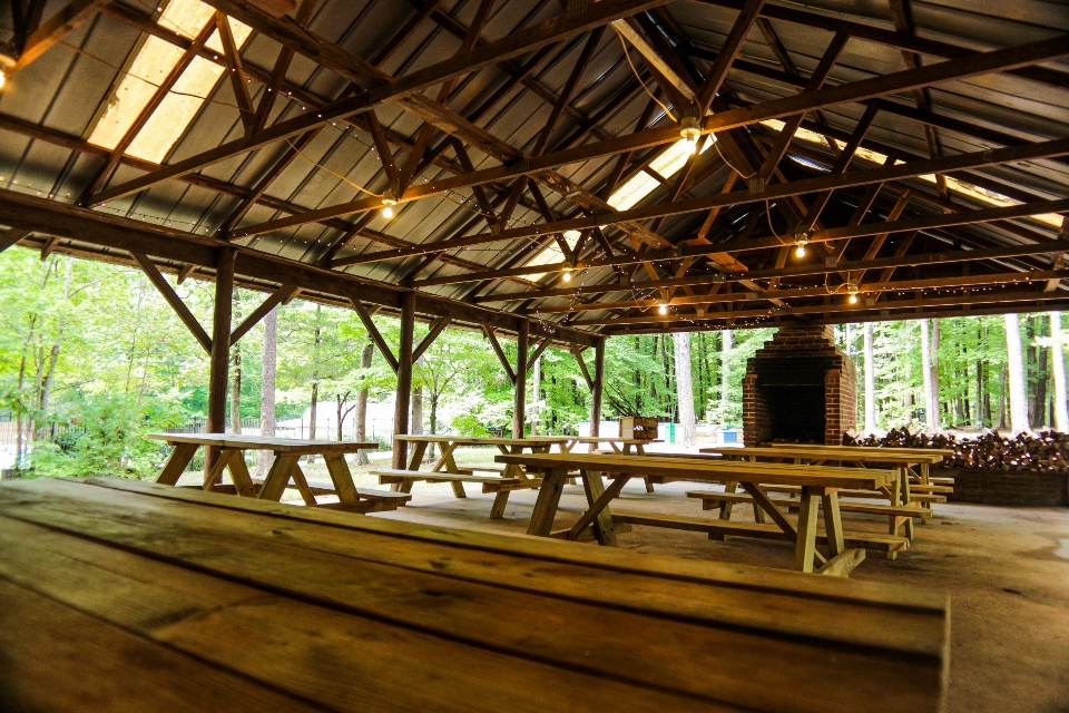 A view of the interior and picinic tables within our bike pavilion, a relaxed part of our Virginia wedding venue.